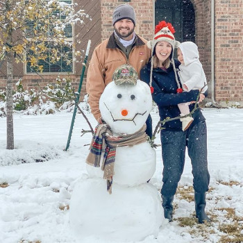 Photo by Rogers-O'Brien Construction on January 11, 2021. Image may contain: 2 people, hat, tree and outdoor.
